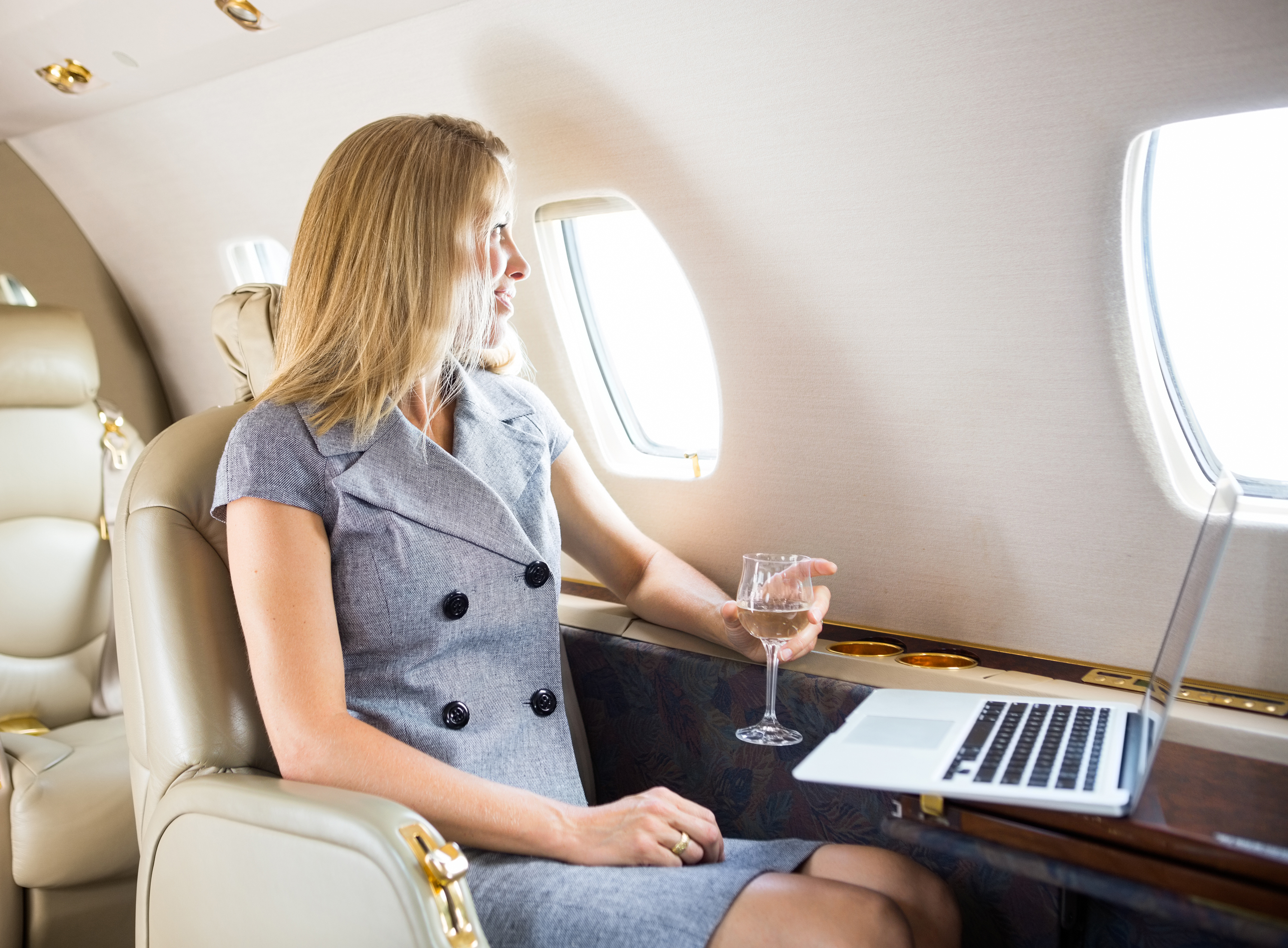 w20-4-woman-sitting-in-first-class