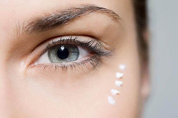woman-with-eye-cream